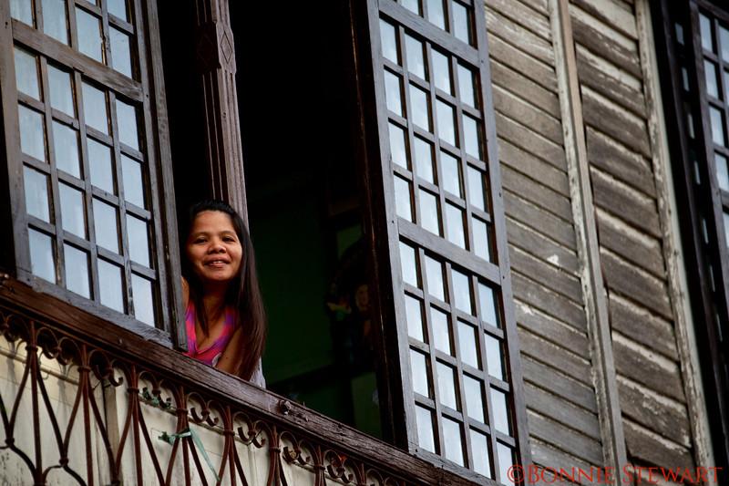 Lady in a window in Vigan