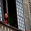 Lady in a window in Vigan