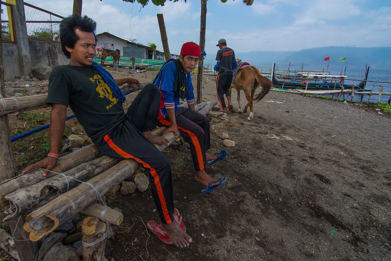 Local villagers hanging out, on the beach on the volcano island in Lake Taal, March 2014.