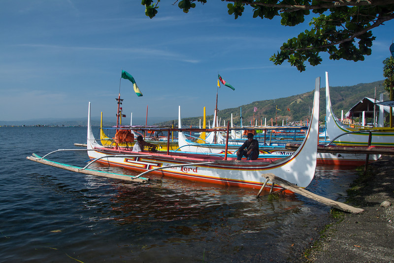 Ornate boats ferry tourists across Lake Taal to visit the volcano island in the middle. March 2014.