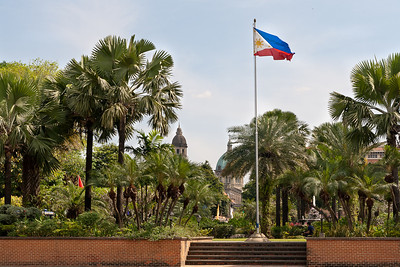 "The proud Philippino flag in front of Fort Santiago says ""Screw you, Spaniards!"""