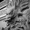 """The monastery was founded in 1906, but the bigger buildings, like this temple with the awesome dragons, are much younger. And they're still building: the new """"Grand Hall of Ten Thousand Buddhas"""" was in construction when we visited."""