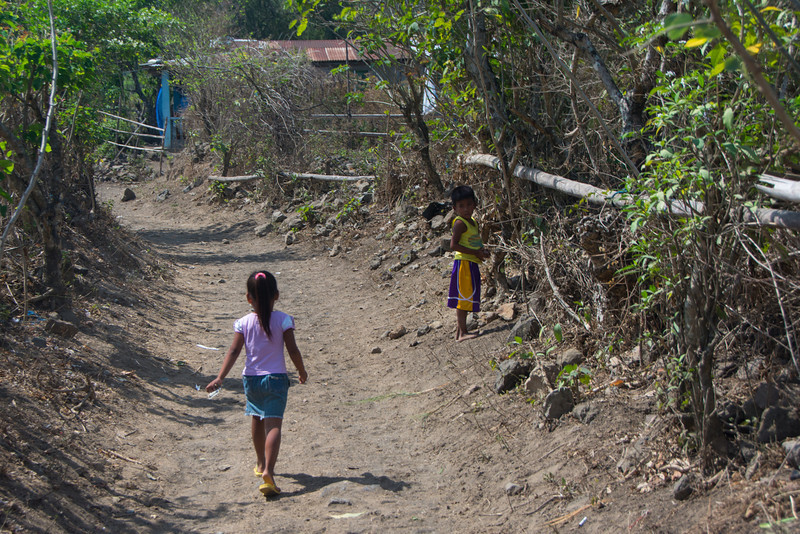 The dry and dusty path through the village up to the crater rim, Lake Taal, March 2014.