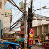 That is not an exceptional cable pole by Filipino standards. It's in Tagbilaran city, Bohol.