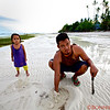 Clam digger searching for clams, Bohol Island