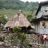 On the left, a traditional Ifugao hut and on the right the kind of house most people live in today.