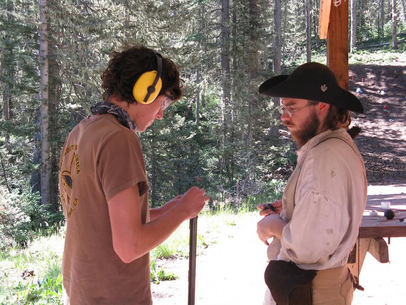 Alex loads his rifle.