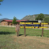 Bruce standing by the Philmont sign.