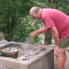 Bill working on his dutch oven dinner.