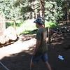 Garrett with a tomahawk.