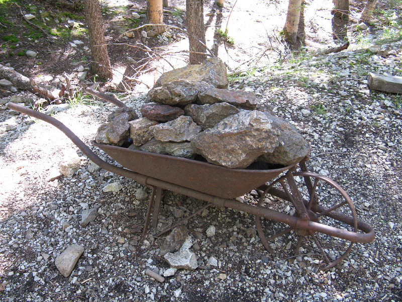 Old wheelbarrow with ore.