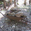 Old wheelbarrow with ore.