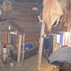 """A very tiny """"trading post"""" in the corner of the fur trapper's cabin."""