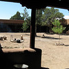 Another view of the courtyard at the hacienda. Food being cooked over the open fire outside.