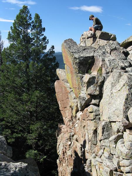 Ian climbing on the rocks.