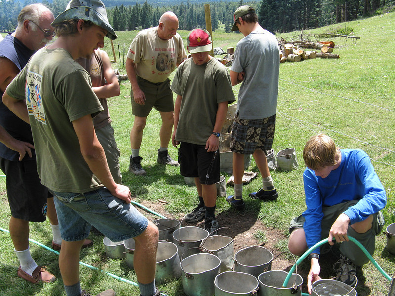 Filling the water pots for the post sweat lodge dousing.