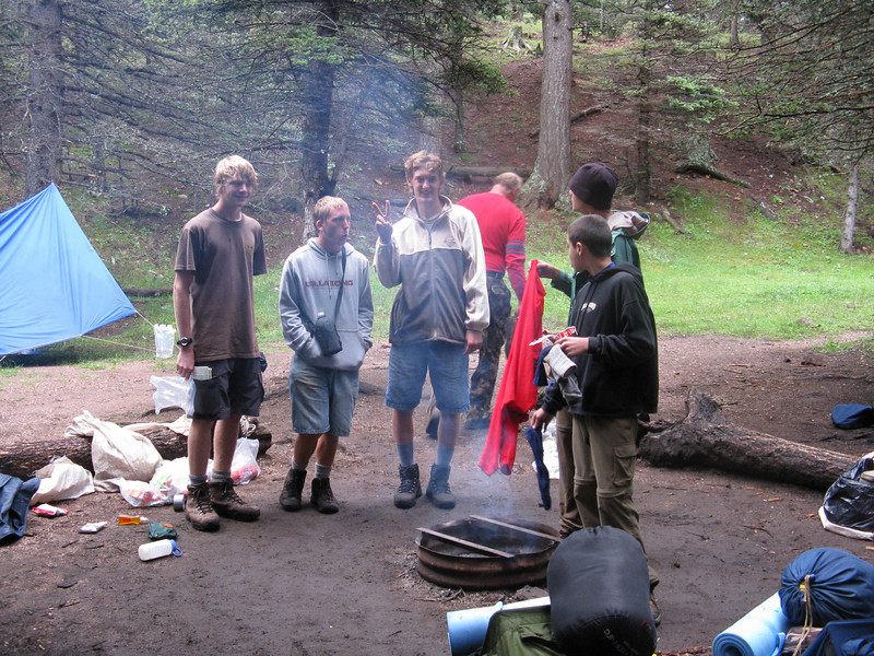 Packing up to leave a very soaked Lower Bonito campsite.
