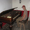Travis plays the very out of tune piano. This was quite the luxury back in the days.