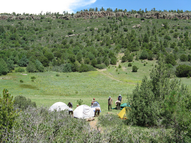 Our tents set up in the meadow under Urraca Mesa.