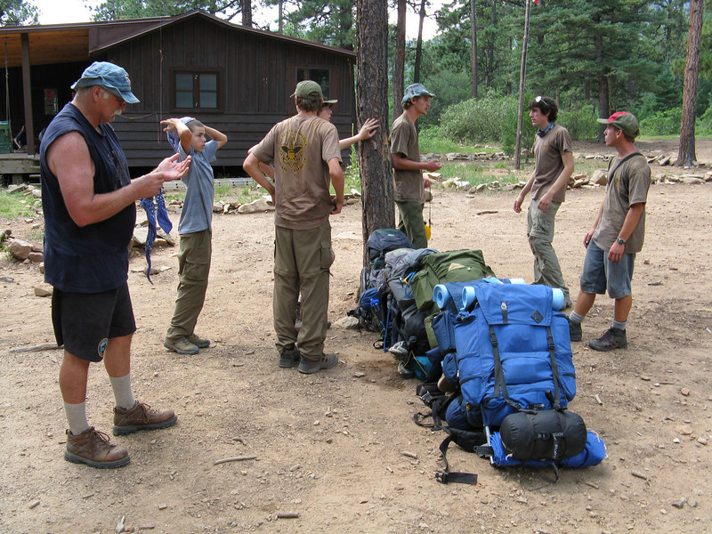 Making a pack line up against a tree so we can go check in.