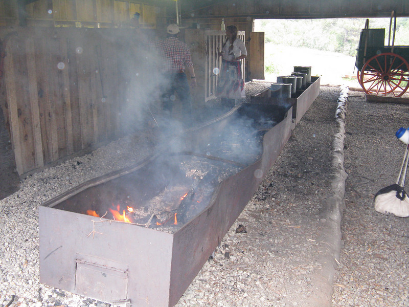 Cooking area for the chuckwagon dinner. Very hot next to the fire, and smoky. The kettles had beef stew, the dutch ovens had biscuits and cobbler.