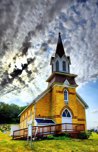 Country church, Basswood, Wisconsin, with sun setting in background.\