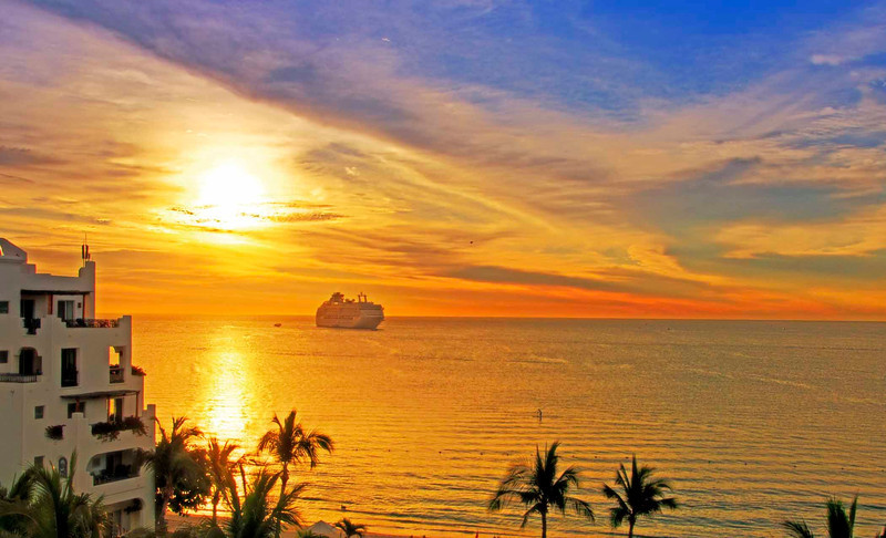 Sunrise with cruise ship approaching, Cabo San Lucas
