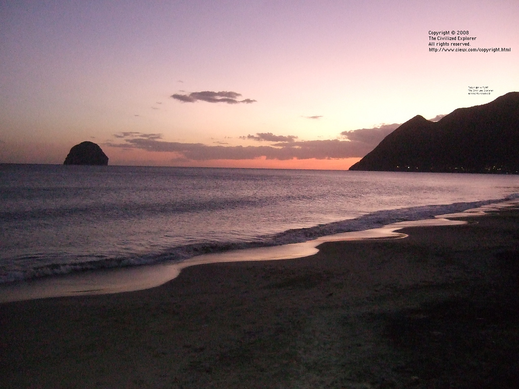 A sunset view from the beach at Anse Cafard.