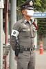 Thai cop wearing a surgical mask.