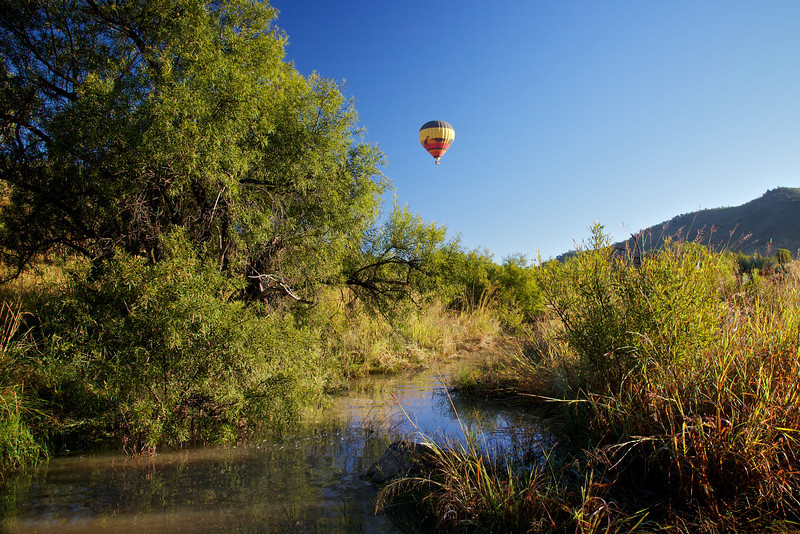 Hot air Baloon over a creek