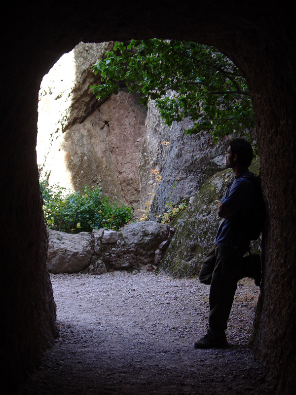 Yours truly at the entrance to the tunnel through the rock