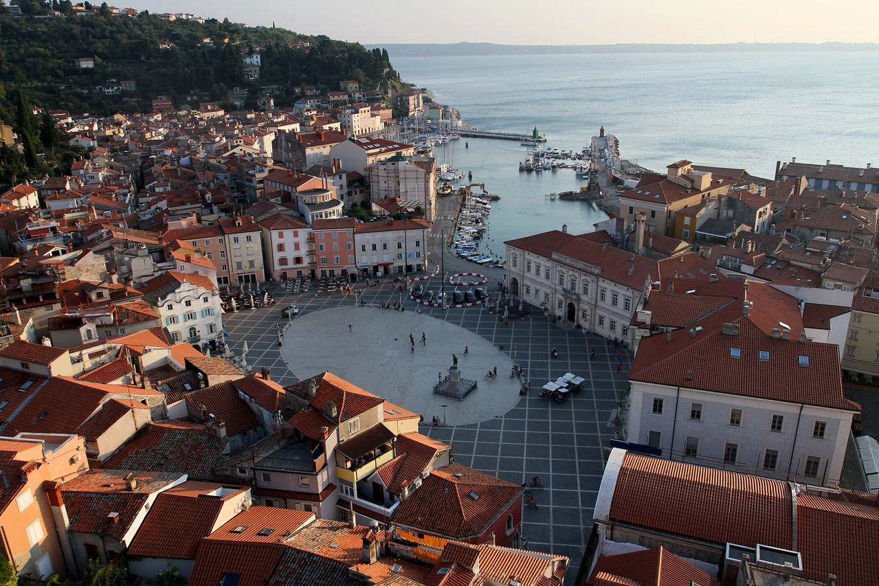 The perfect view - the Tartinijev Trg - Tartini Square with it's polished marble was once part of the protected harbor, but in 1894 it smelled so bad that they decided to fill it in.  Good move.
