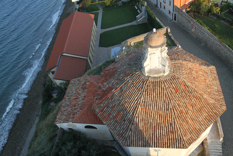 Octagonal baptistery (krstilnica) from above in the evening sun