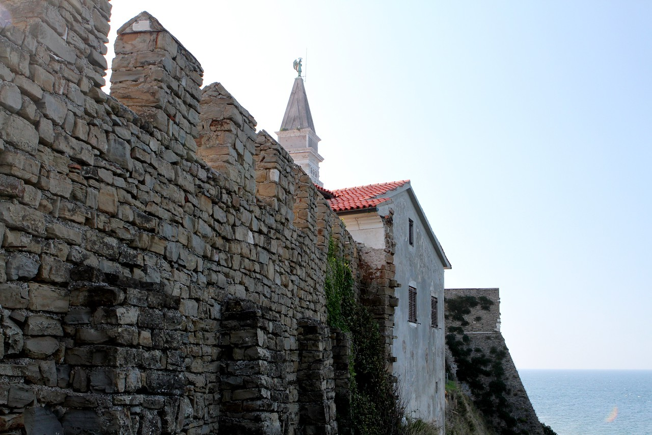 The 15th century town walls , complete with loop-holes which once ran from the sea and all the way to the harbor.
