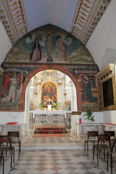 Around the corner is the Church of Our Lady of the Snows with this 15th century arch painting of the Crucifixion.