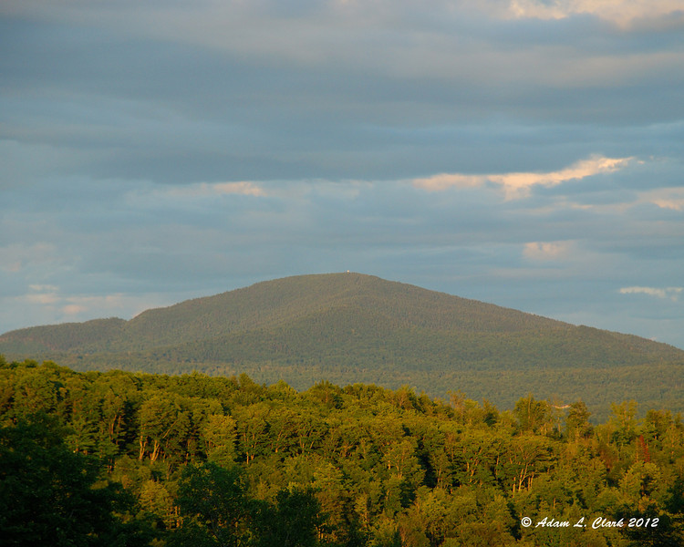 Mt. Magalloway near sunset.  The spot on top is the fire tower