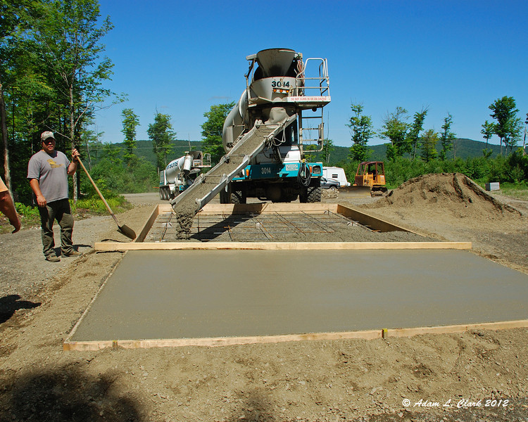 Almost halfway poured with the second truck in the background