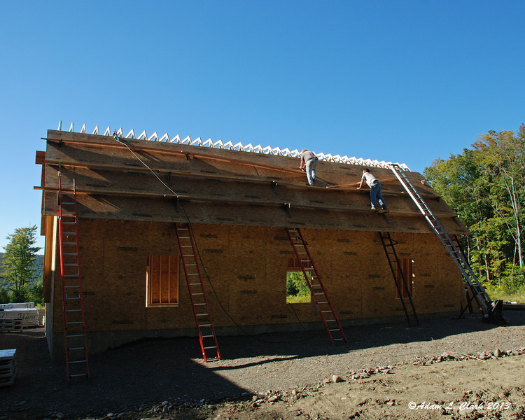 Adding more staging so that we can put the top piece of the trusses on and add more sheets of Advantech