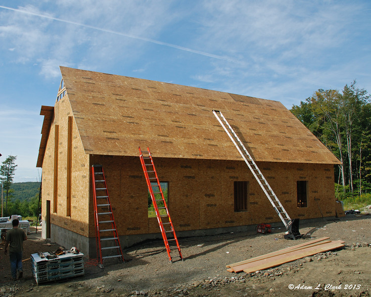 Done for the weekend... we got the tops of the trusses up, more sheets of Advantech on the front, and the entire back side done