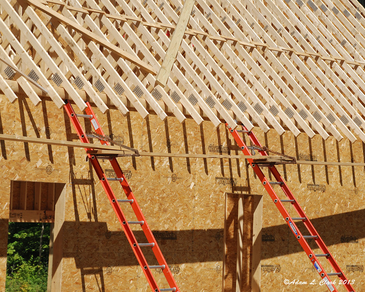 Ladder brackets with planks for working on