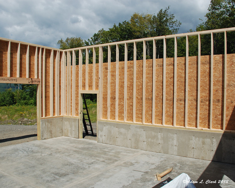 The sides aren't done up to the tops so that the next sheet will help tie the wall to the trusses that are coming next weekend
