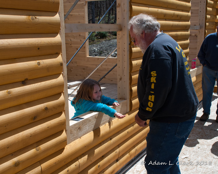 Grampy paying for ice cream at the window Liliana decided was an ice cream shop for the weekend