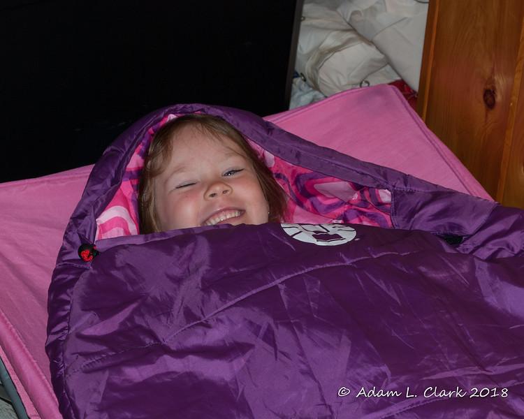 She really enjoys her cot and sleeping bag
