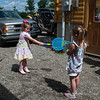 Liliana making bubbles and Autumn trying to hit them with a racket