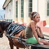 Young Girl on a Horse Carriage