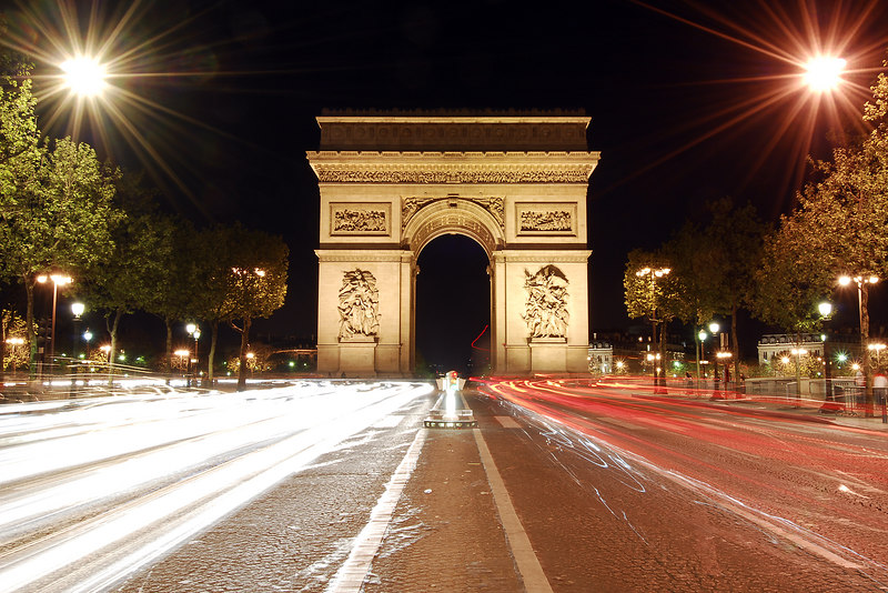 Arc de Triomphe at night with traffic, Paris, France