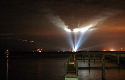 Space Shuttle Endeavor on the launchpad for mission STS-130. Streak of light at left is weather Reconnaissance Aircraft T-38 jet taking off -- Feb 8, 2010