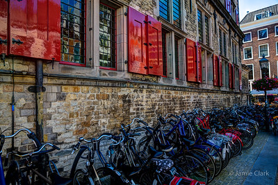 Lots of bicycles lined up along the Stadhuis. Delft, Netherlands.