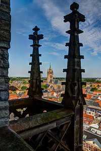 Old Church trapped between two spires, much like I am trapped here. Really... time to go down now. Top of New Church. Delft. Netherlands.
