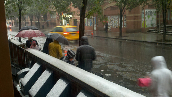 Rare October snow storm in New York City. West 49th St just west of 8th Ave, NYC
